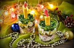 Слоеный салат, оформленный в виде свечи